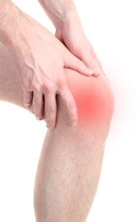 articulaciones: Hombre que sostiene la rodilla dolorida, aislado en blanco Foto de archivo
