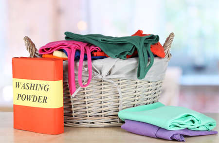 Clothes in wooden basket on table in room Stock Photo - 17797393