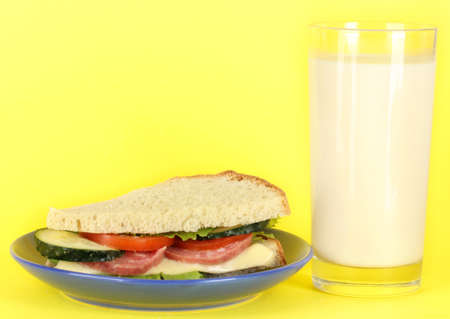 Sandwich on plate with milk on yellow background Stock Photo - 17756061