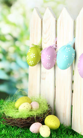 Art Easter background with eggs hanging on fence Stock Photo - 17756239