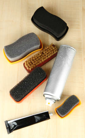 Set of stuff for cleaning and polish shoes, on wooden background Stock Photo - 17793841