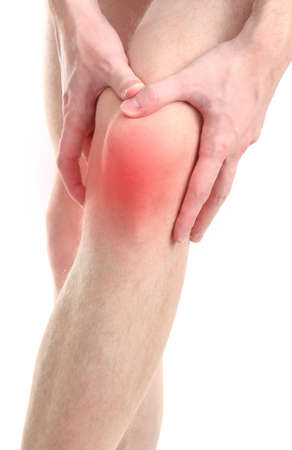 knee joint: Man holding sore knee, isolated on white Stock Photo