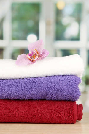 Stack of towels with fragrant flower on window background Stock Photo - 17768883