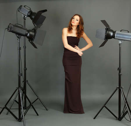 Beautiful professional female model resting between shots in photography studio shoot set-up Stock Photo - 18040060