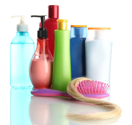 comb brush with hair and cosmetic bottles, isolated on white Stock Photo - 17768729