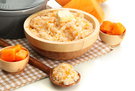 Taste rice porridge with pumpkin, isolated on white  photo