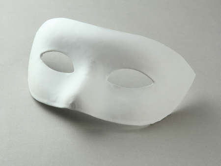 White mask, on grey background photo