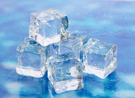 Ice on brightblue background photo