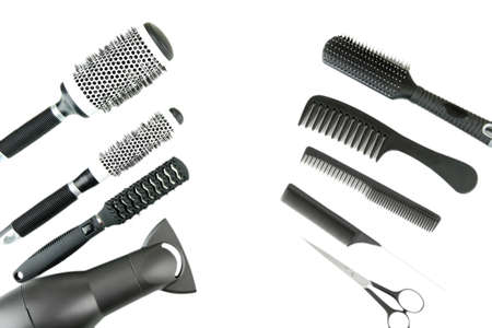 Comb brushes, hairdryer and cutting shears, isolated on white Stock Photo - 17768758
