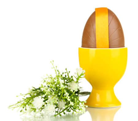 elliptic: Chocolate egg in stand isolated on white