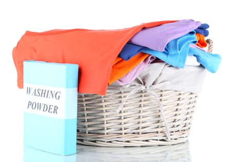 Clothes with washing powder in wooden basket isolated on white Stock Photo - 17768973