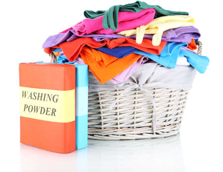 Clothes with washing powder in wooden basket isolated on white Stock Photo - 17768989