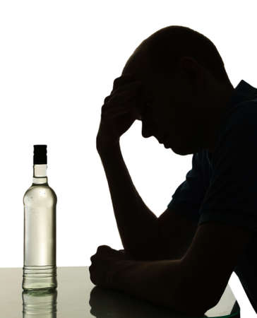 Silhouette of man with bottle of alcohol, isolated on white photo