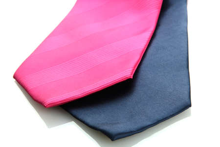 pink and blue ties isolated on white photo