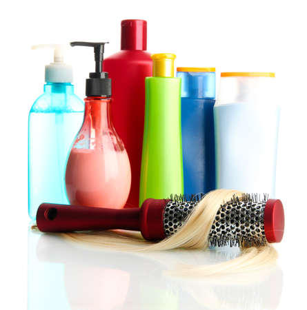 comb brush with hair and cosmetic bottles, isolated on white Stock Photo - 17769144