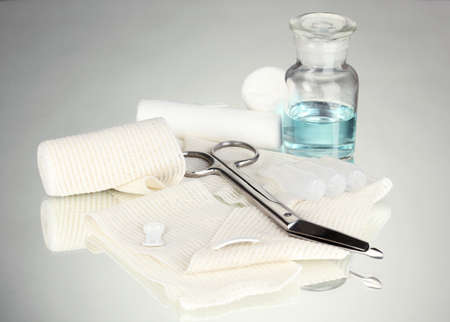 First aid kit for bandaging on grey background Stock Photo - 17769302