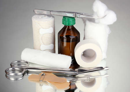 First aid kit for bandaging on grey background Stock Photo - 17769328