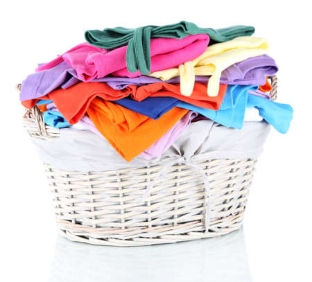 washing clothes: Clothes in wooden basket isolated on white Stock Photo