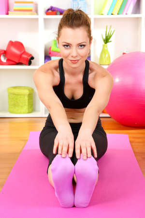 Young woman doing fitness exercises at home Stock Photo - 18040304
