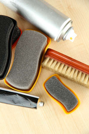 Set of stuff for cleaning and polish shoes, on wooden background Stock Photo - 17769454
