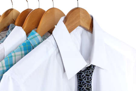 Shirts with ties on wooden hangers isolated on white Stock Photo - 17769388