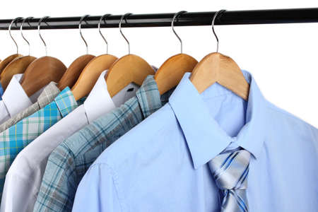 Shirts with ties on wooden hangers isolated on white Stock Photo - 17769419