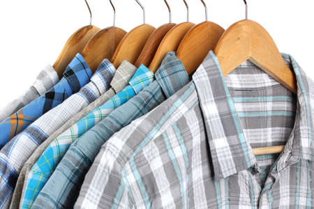 Shirts with ties on wooden hangers isolated on white Stock Photo - 17769448