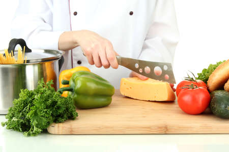 Female hands cutting cheese, isolated on white photo
