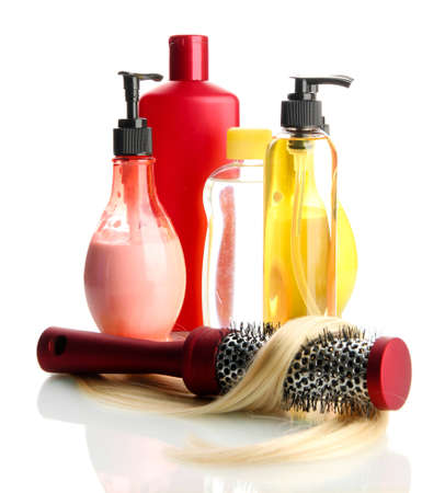 comb brush with hair and cosmetic bottles, isolated on white Stock Photo - 17771110