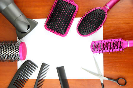 Comb brushes, hairdryer and cutting shears,on wooden background Stock Photo - 17771186