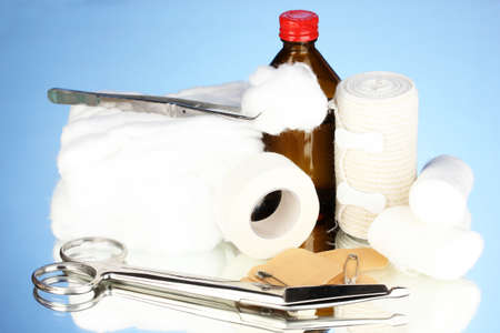 First aid kit for bandaging on blue background Stock Photo - 17771149