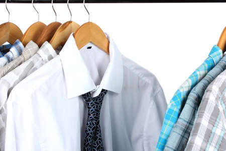 Shirts with ties on wooden hangers isolated on white Stock Photo - 17771127