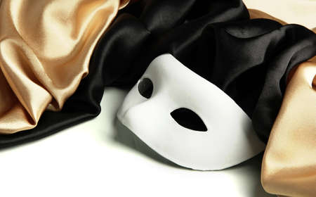 White mask and silk fabric, isolated on white photo