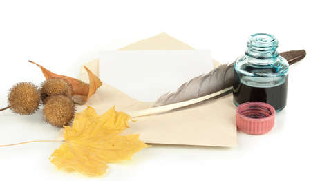 Old envelope with blank paper and autumn leafs isolated on white photo