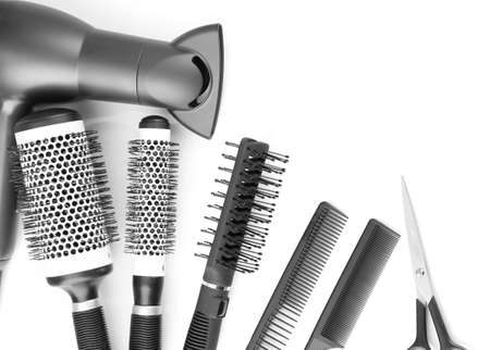 hairdryer: Comb brushes, hairdryer and cutting shears, isolated on white