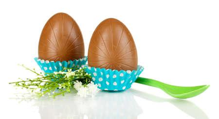 elliptic: Chocolate eggs in napkin isolated on white