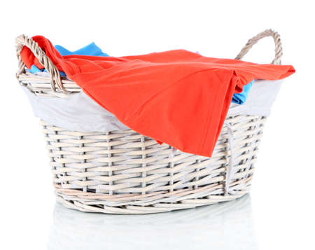 Clothes in wooden basket isolated on white Stock Photo - 17771312