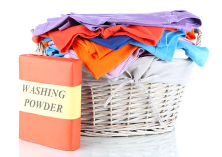Clothes with washing powder in wooden basket isolated on white Stock Photo - 17771338