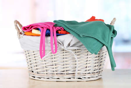 Clothes in wooden basket on table in room Stock Photo - 17771408
