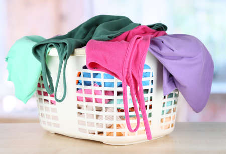 Clothes in plastic basket on table in room Stock Photo - 17771418