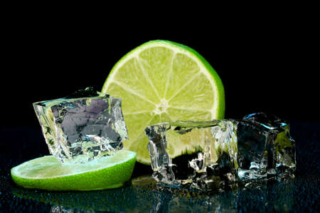 darck: Ice cubes with lime on darck background Stock Photo