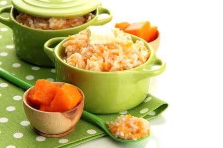 Taste rice porridge with pumpkin in saucepans, isolated on white Stock Photo - 17821922