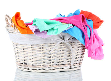 Clothes in wooden basket isolated on white Stock Photo - 17823805
