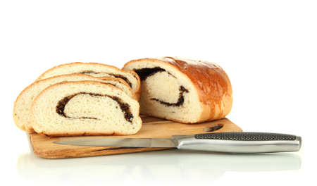 Loaf with poppy seeds on cutting board, isolated on white photo