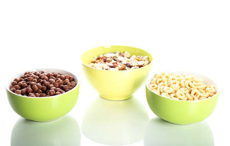 Delicious and healthy cereal in bowls isolated on white Stock Photo - 17823191