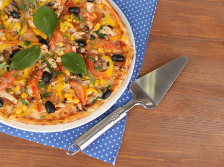 Tasty pizza on wooden table close-up Stock Photo - 17826814