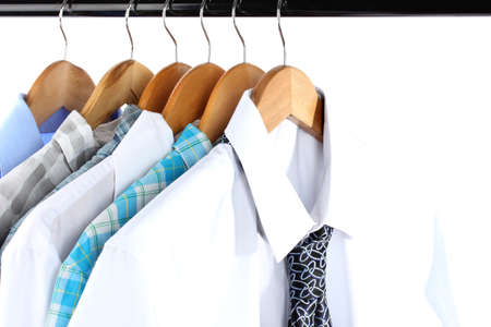 Shirts with ties on wooden hangers isolated on white Stock Photo - 17823901