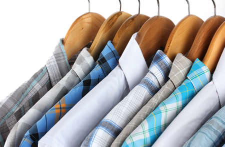 Shirts with ties on wooden hangers isolated on white Stock Photo - 17826355