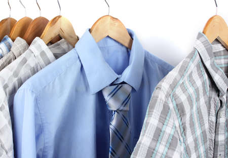 Shirts with ties on wooden hangers isolated on white Stock Photo - 17826772