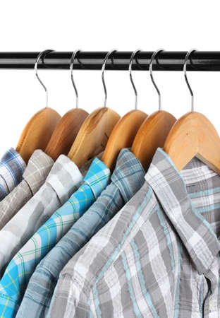 Shirts with ties on wooden hangers isolated on white Stock Photo - 17826366